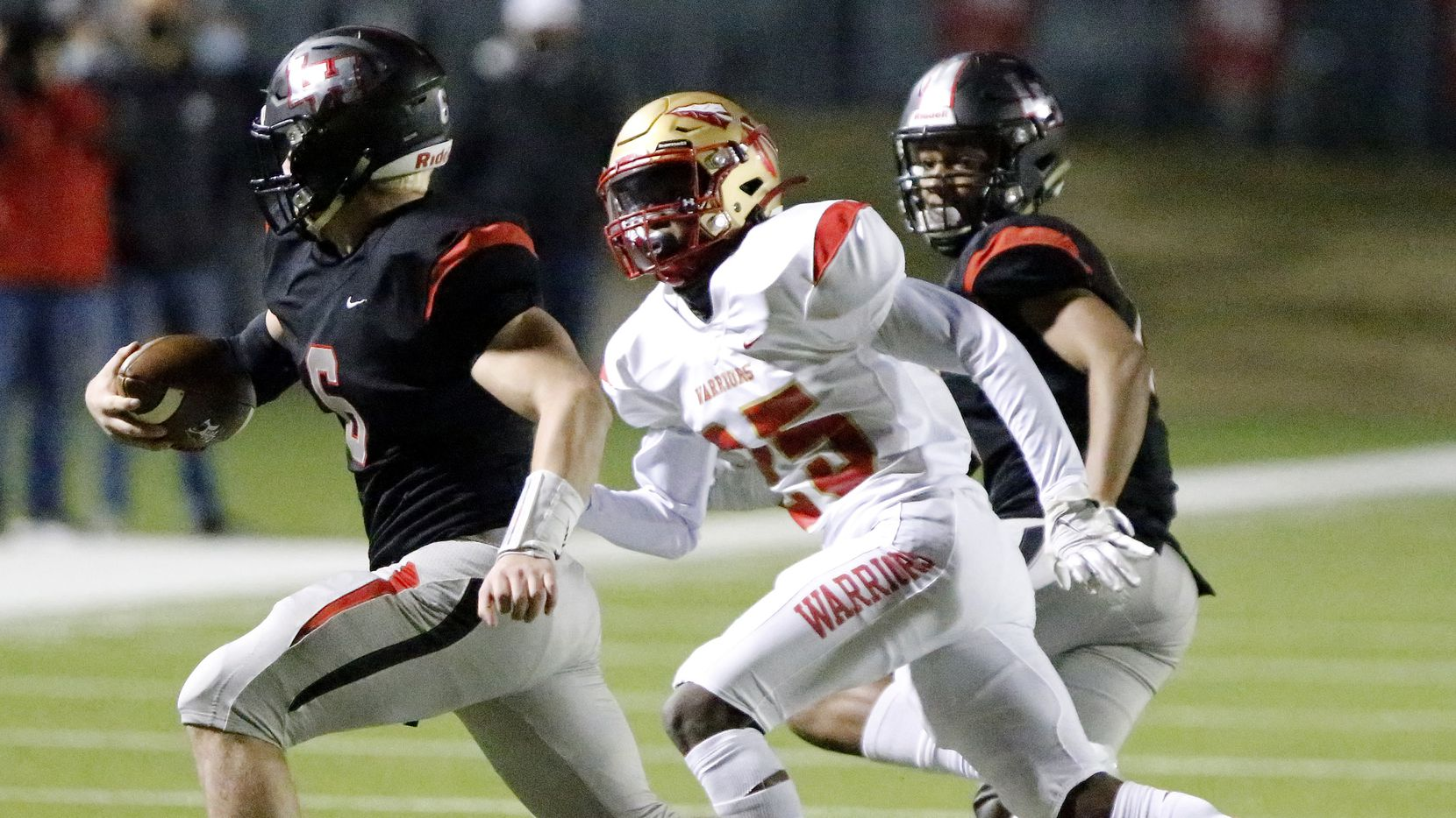 Lake Highlands High School quarterback Mitch Coulson (6) is tackled by South Grand Prairie High School defensive back Darius Carmouche (25) during the first half as Lake Highlands High School hosted South Grand Prairie High School at Wildcat-Ram Stadium in Dallas on Friday night, December 11, 2020.