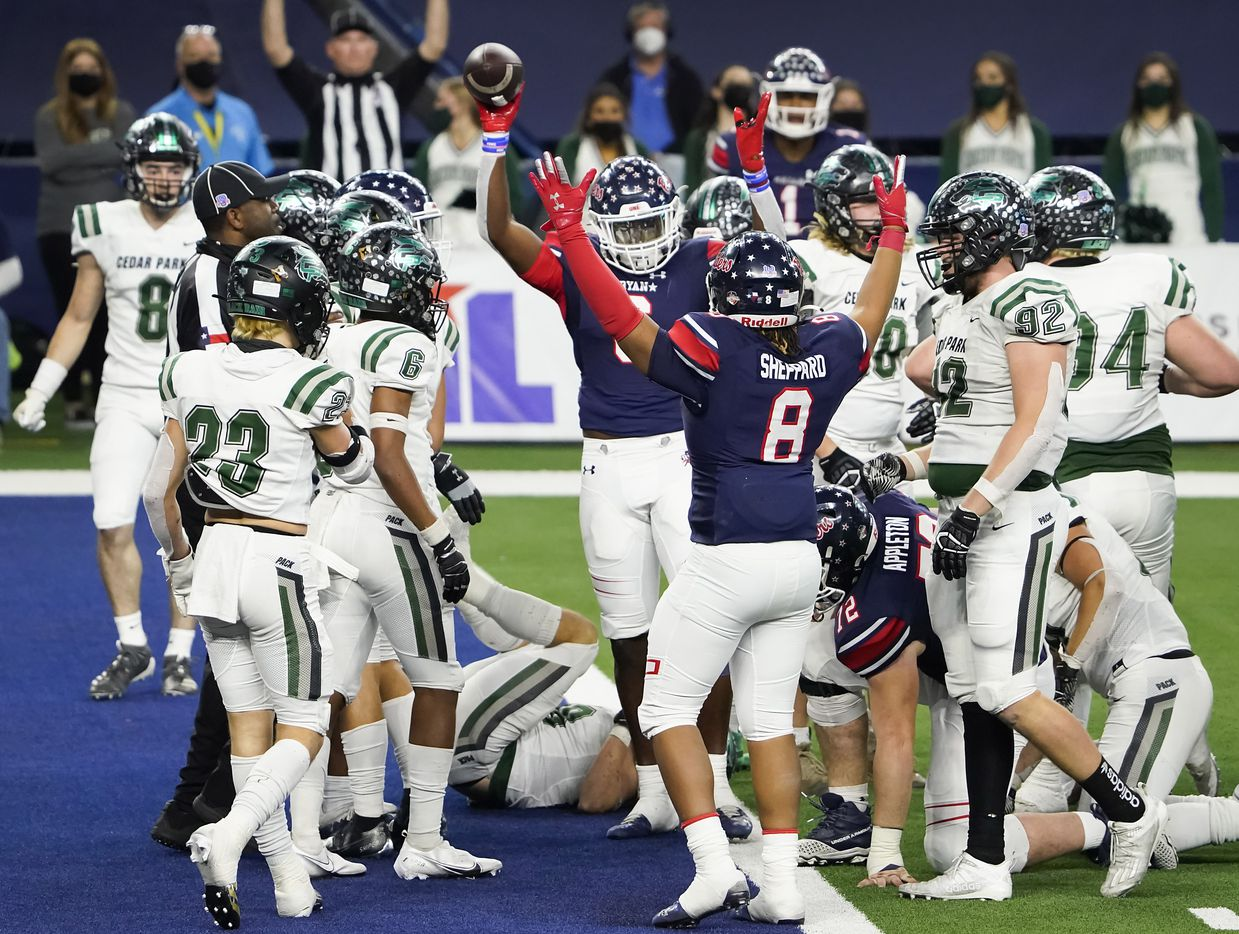 Denton Ryan Anthony Hill Jr. (6) celebrates with teammate Jay Sheppard (8) after scoring on a short touchdown run during the first half of the Class 5A Division I state football championship game against Cedar Park at AT&T Stadium on Friday, Jan. 15, 2021, in Arlington, Texas. (Smiley N. Pool/The Dallas Morning News)