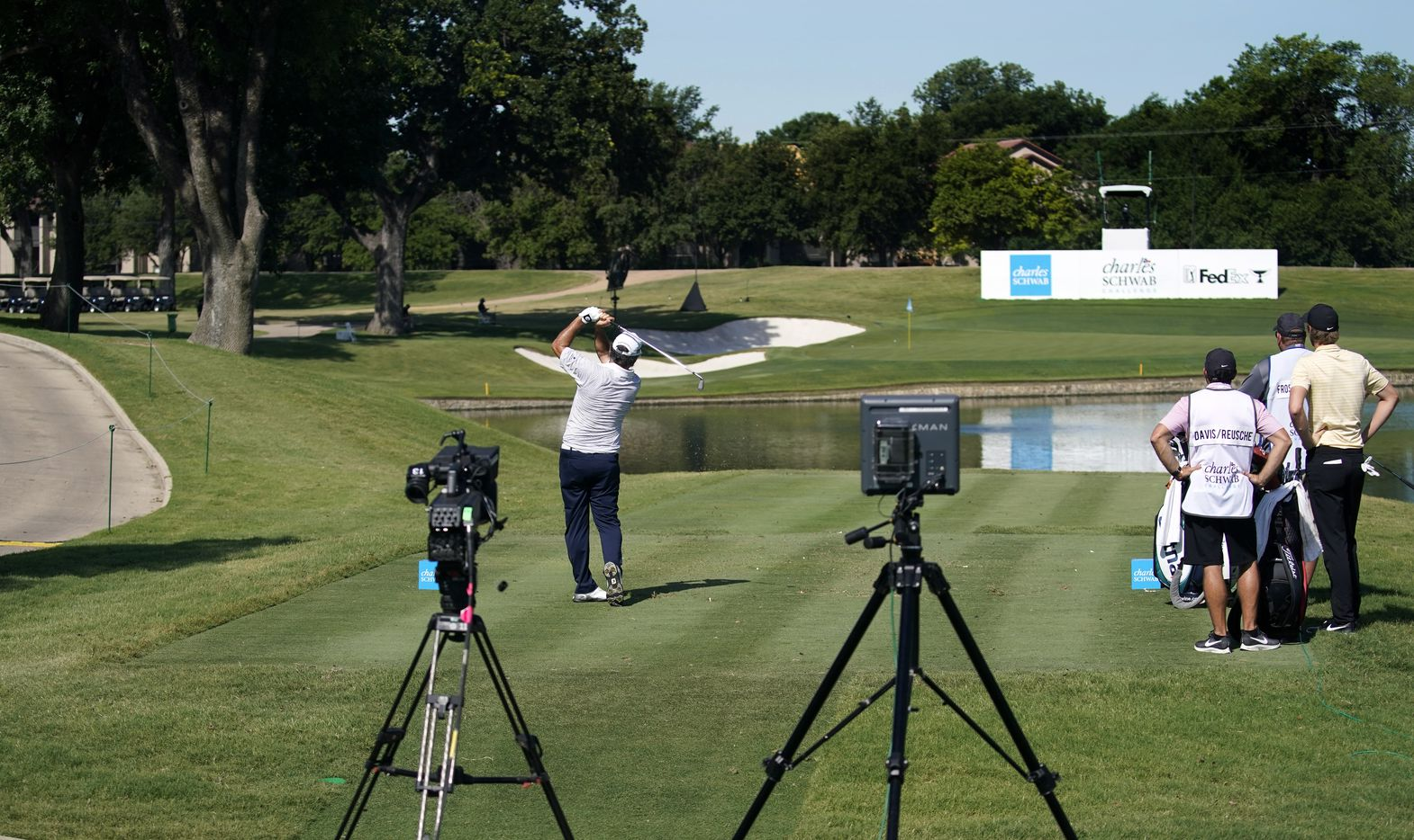 With no fans around the 13th tee box, PGA Tour golfer David Frost watches his shot across the pond during the second round of the Charles Schwab Challenge at the Colonial Country Club in Fort Worth, Friday, June 12, 2020.  The Challenge is the first tour event since the COVID-19 pandemic began. (Tom Fox/The Dallas Morning News)