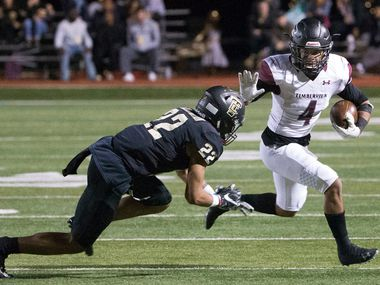 Mansfield Timberview running back Montaye Dawson (4) attempts to stiff-arm The Colony's Christian Gonzalez (22) during Timberview's 35-30 win. (Daniel Carde/The Dallas Morning News)