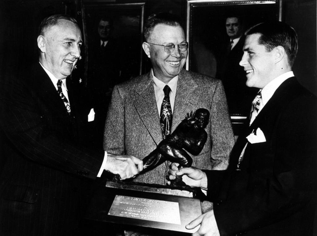 Doak Walker receives Heisman Trophy.