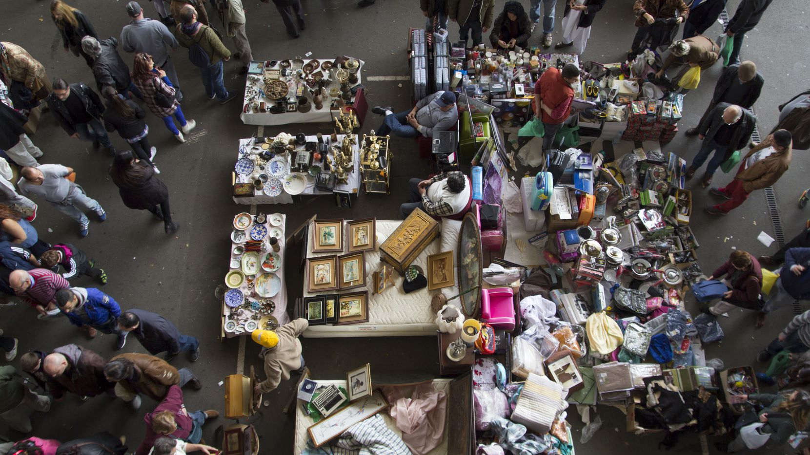A crowd flocks to a flea market in Barcelona, Spain. (Getty Images)