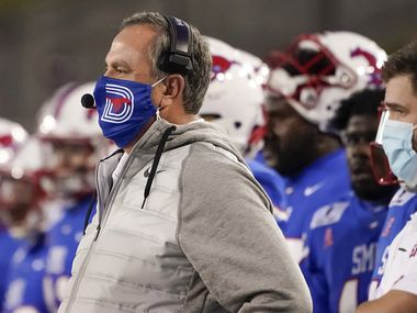 FILE - SMU head coach Sonny Dykes watches from the sidelines during the first quarter of an NCAA football game against Navy at Ford Stadium on Saturday, Oct. 31, 2020, in Dallas.