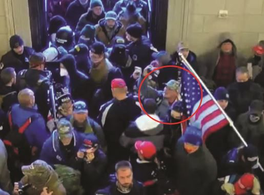 Jason Hyland, shown in red circle, was inside the U.S. Capitol on Jan. 6, according to government authorities.