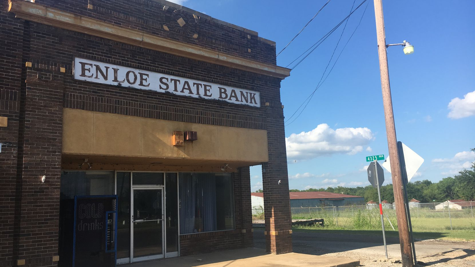 The building that once housed the Enloe State Bank. The building sits on the corner of a stretch of empty storefronts.