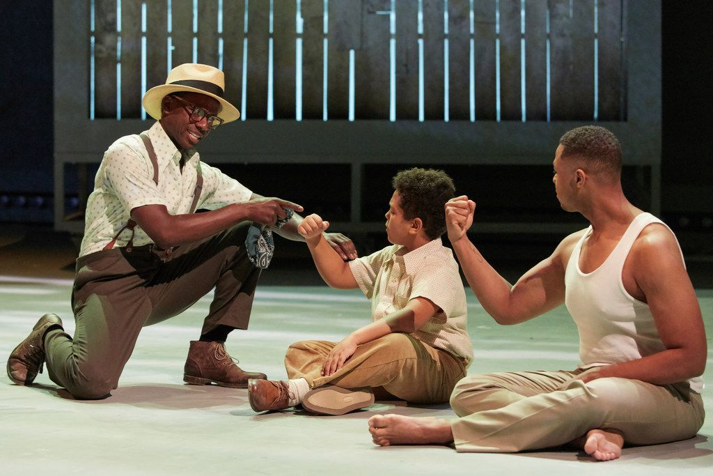 Michael Redding as Uncle Paul (left), Jeremy Denis as the young Charles Blow, and Davóne Tines as the adult Charles Blow in the world premiere of Terence Blanchard and Kasi Lemmons' Fire Shut Up in My Bones, performed at the Opera Theatre of St. Louis.