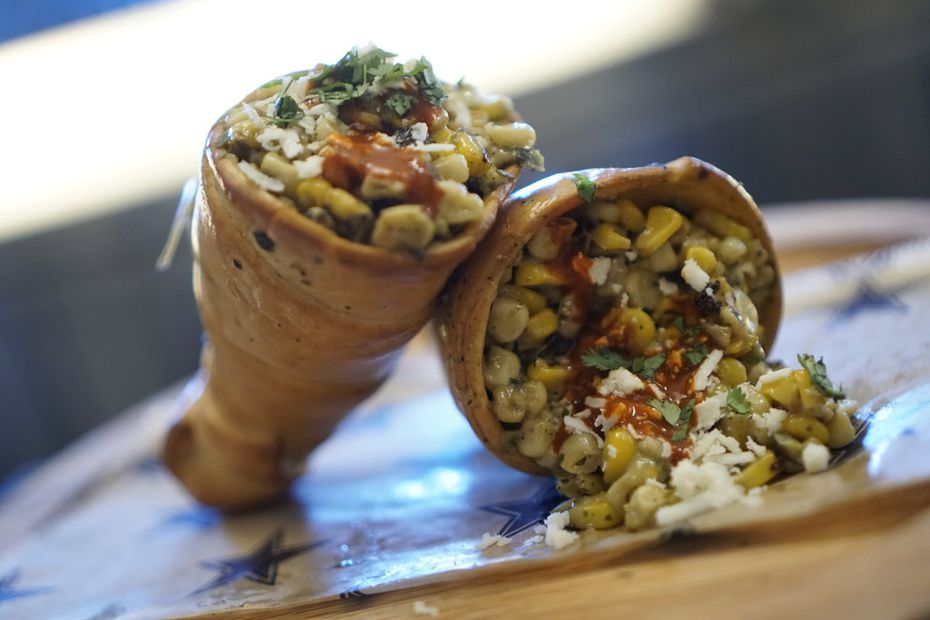 Elotes inside an edible bread cone? They're creamy and spicy. This new item is available at AT&T Stadium for Dallas Cowboys games.