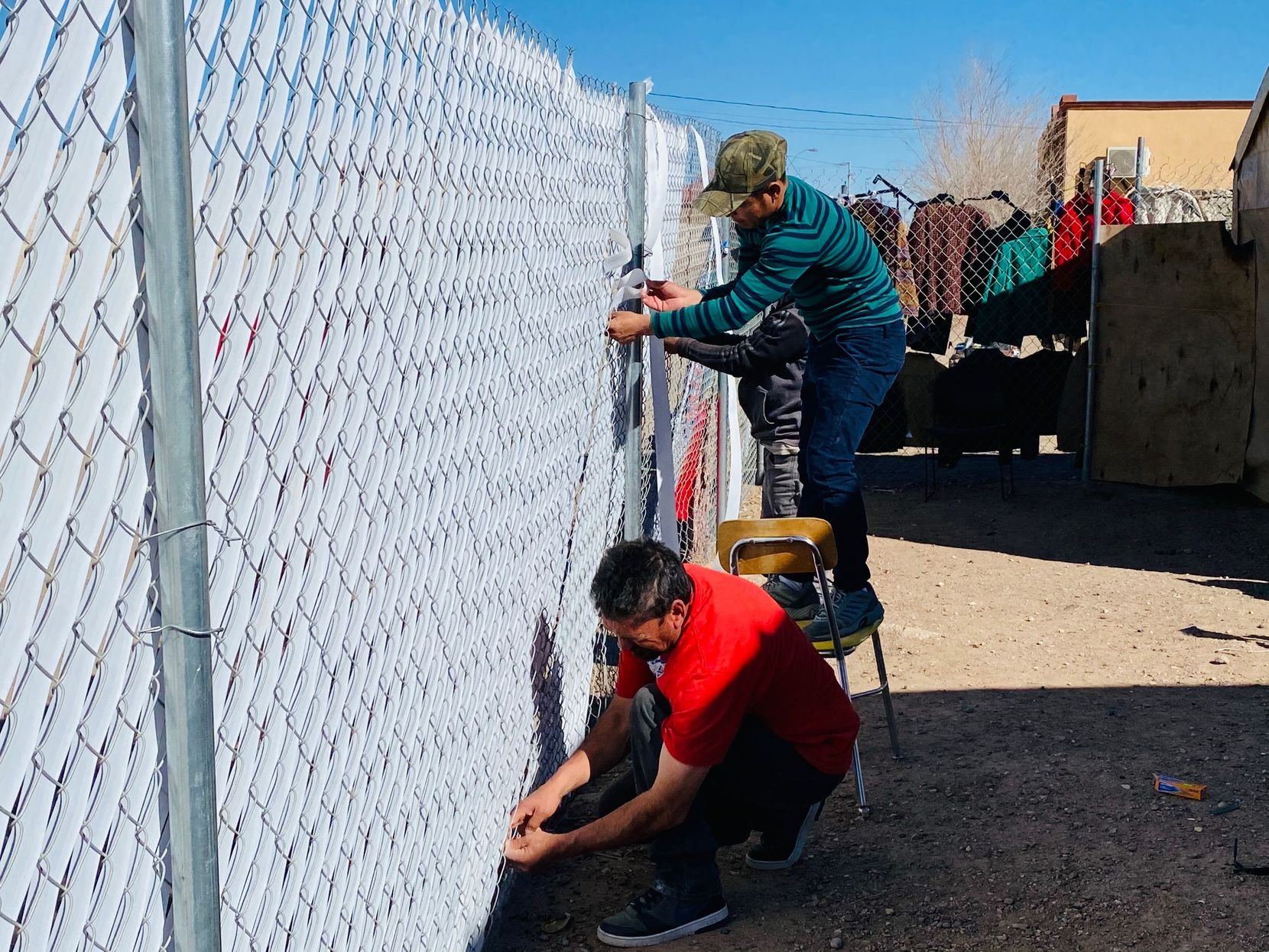 Migrants at the Tierra de Oro, or Land of Gold shelter, volunteer to expand the facility in anticipation of a migration surge. The two migrants worked on the shelter in February 2021 in the tiny town of Paloma, Mexico, about 100 miles west of El Paso.