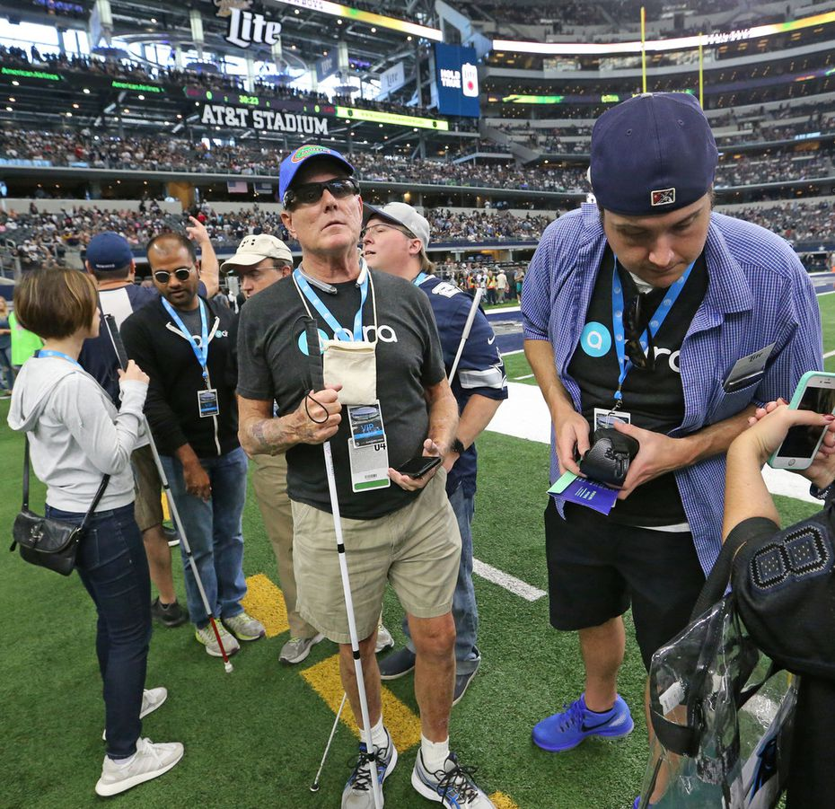 Pete Lane visits the sidelines at AT&T Stadium.