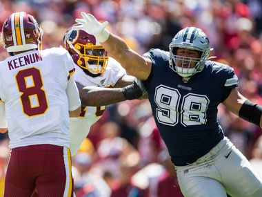 Dallas Cowboys defensive tackle Tyrone Crawford (98) threatens Washington Redskins quarterback Case Keenum (8) during the first quarter of an NFL game between the Dallas Cowboys and the Washington Redskins on Sunday, September 15, 2019 at FedExField in Landover, Maryland.