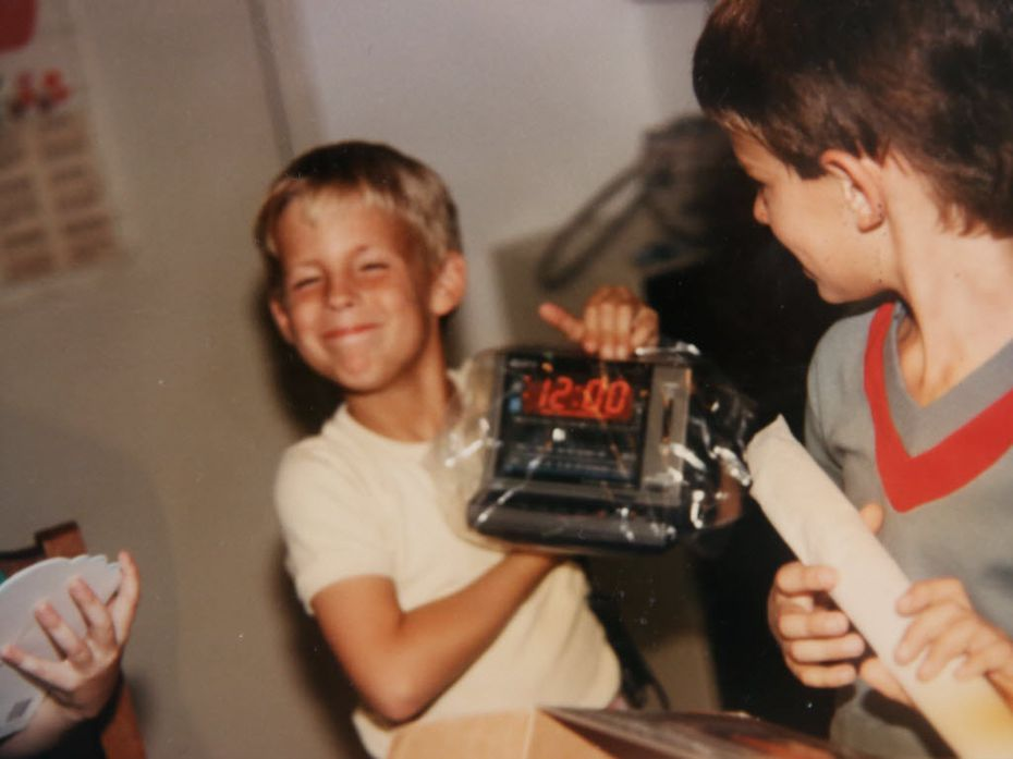 Brad Hunstable holds up a digital clock radio he got for his 8th birthday in 1986. Brad taught himself to use computers and went on to co-found Ustream, a pioneer in live video streaming.
