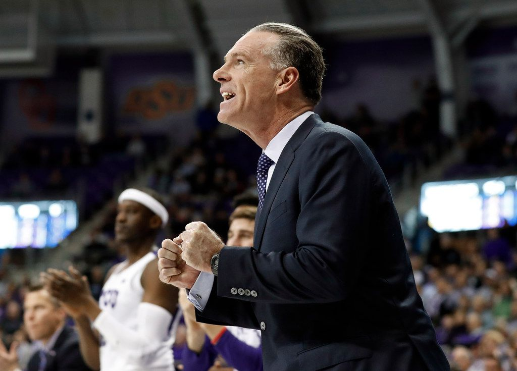 FILE - TCU head coach Jamie Dixon celebrates a basket against Kansas State in the first half of an NCAA college basketball game in Fort Worth, Texas, Monday, March 4, 2019. (AP Photo/Tony Gutierrez)