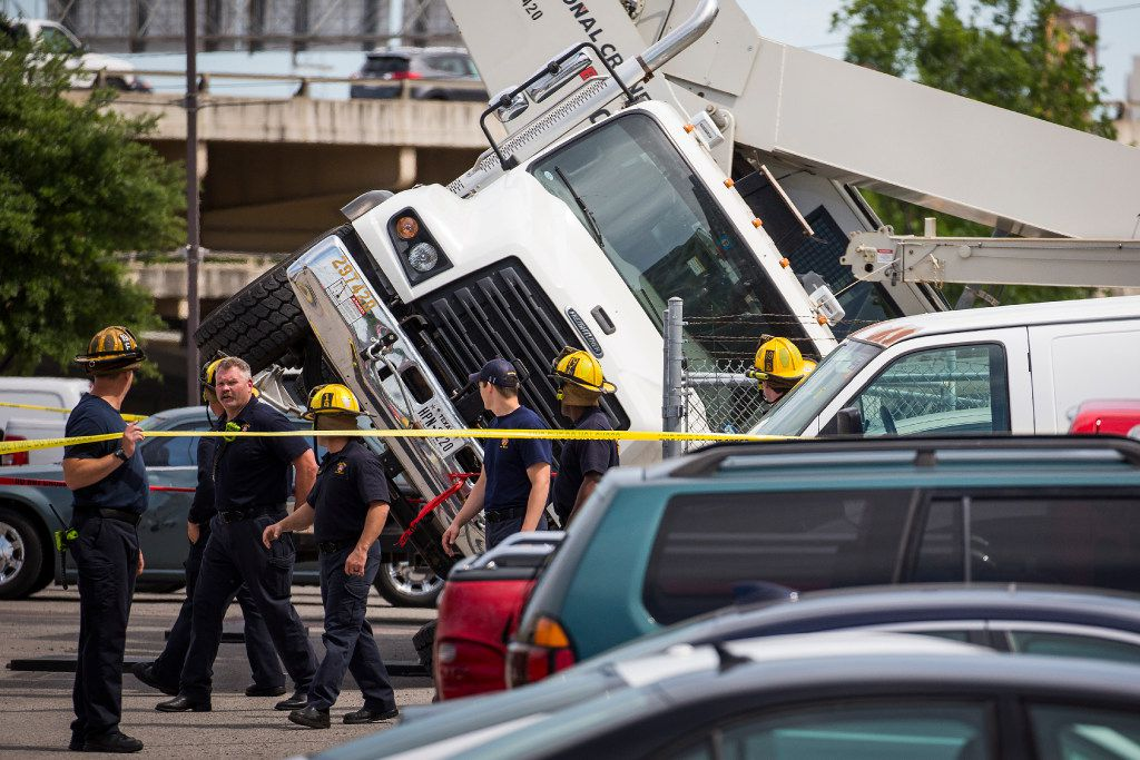 Dallas Fire-Rescue responds to a scene at 1700 Arts Plaza (near Ross Ave. and Flora Street) where a crane accident resulted in a fatality on Monday, April 24, 2017, in Dallas.  One person was killed, one was transported to the hospital with injuries that were not life-threatening and one person was treated and released at the scene. (Smiley N. Pool/The Dallas Morning News)