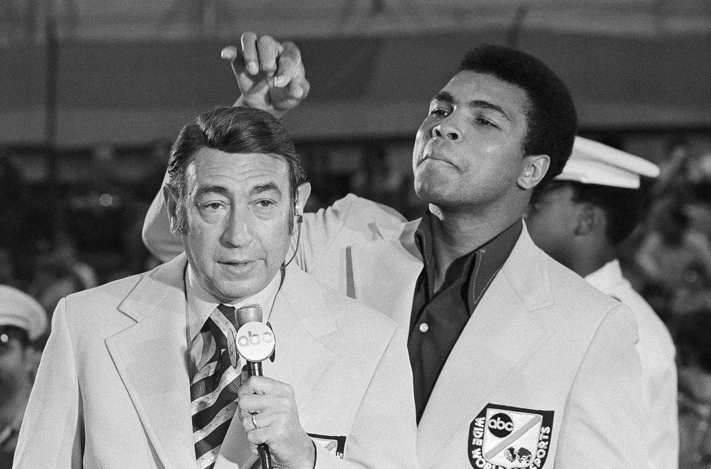 In this Aug. 7, 1972, file photo, Muhammad Ali jokes with television sports commentator  Howard Cosell before the start of the Olympic boxing trials, in West Point, NY.