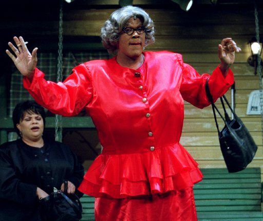 Madea, played by Tyler Perry, offers her humorous point of view on relationships as Cora, played by Tamela Mann, listens in the background during a performance of 'Madea's Family Reunion' at the Dallas Convention Center Theater in 2002.