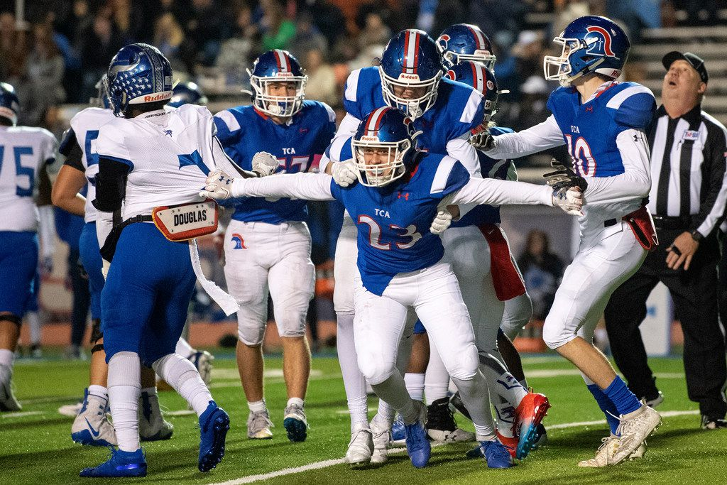 TCA-Addison freshman safety Chance Snyder (23) celebrates an interception against Fort Worth Nolan in the first half of a high school football game on Friday, November 8, 2019 at Tom Landry Stadium in Addison, Texas.