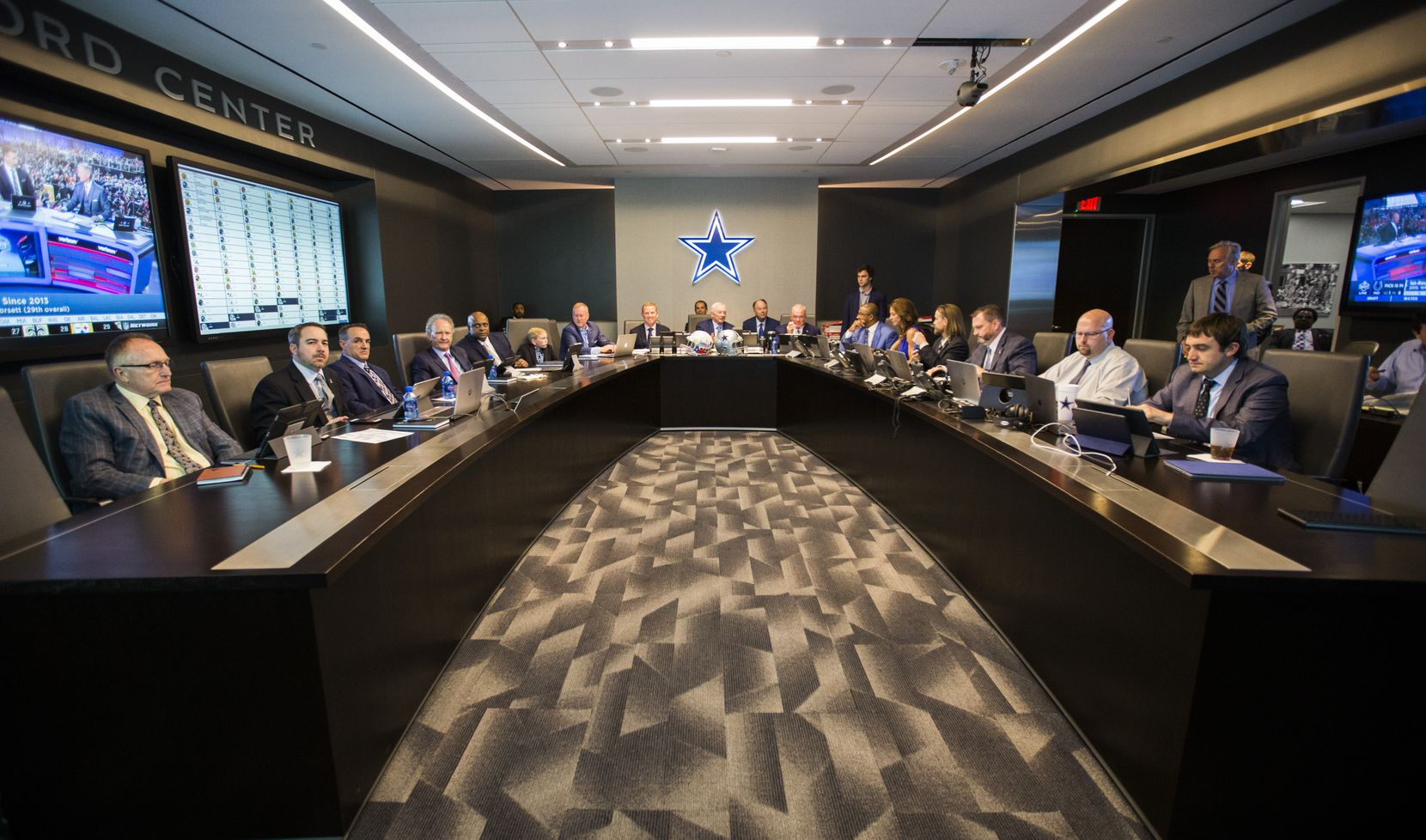 FILE - Cowboys owner Jerry Jones (center), then-head coach Jason Garrett (center-left), executive vice president Stephen Jones (center-right) and other executives wait to make their first pick of the 2018 NFL draft on Thursday, April 26, 2018 at The Star in Frisco.