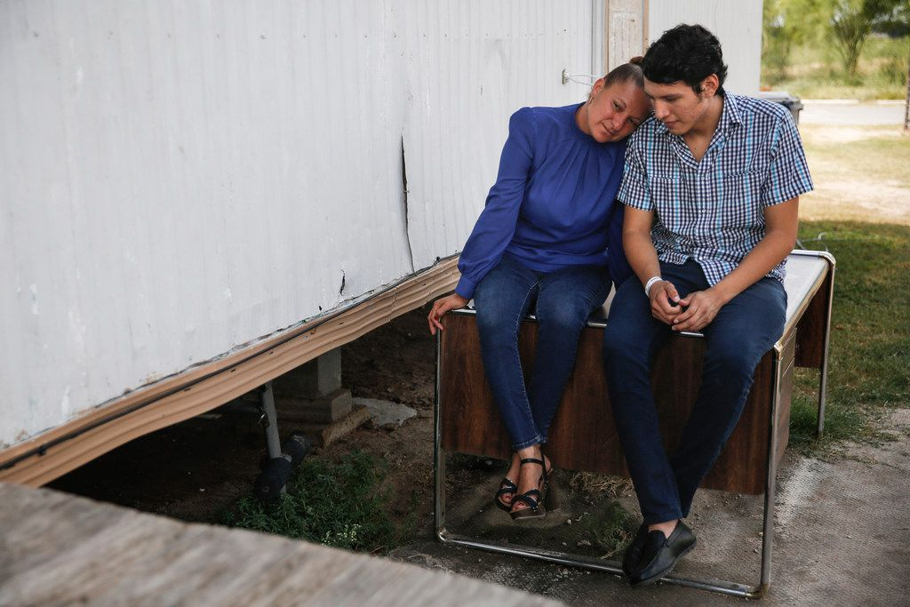 Sanjuana Galicia leaned into son Francisco's shoulder as they talked outside their home in July.