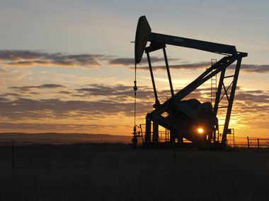 This file photo shows a Whiting Petroleum Co. pump jack in the Bakken region of the Northern Plains near Bainville, Mont.