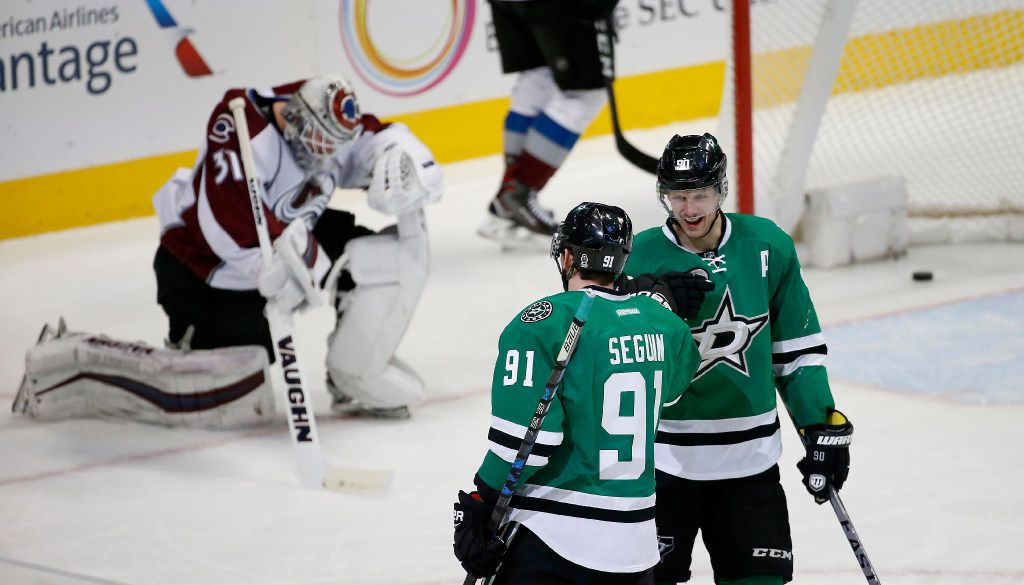 Dallas Stars center Tyler Seguin (91) is congratulated by center Jason Spezza after scoring a goal on Colorado Avalanche goalie Calvin Pickard (31) during the first period at American Airlines Center in Dallas, Thursday, Dec. 29, 2016. (Jae S. Lee/The Dallas Morning News)