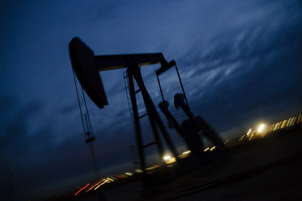 A pump jack stands at dusk on Dec. 16, 2018, in the Permian Basin area in Texas. Bloomberg photo by Angus Mordant