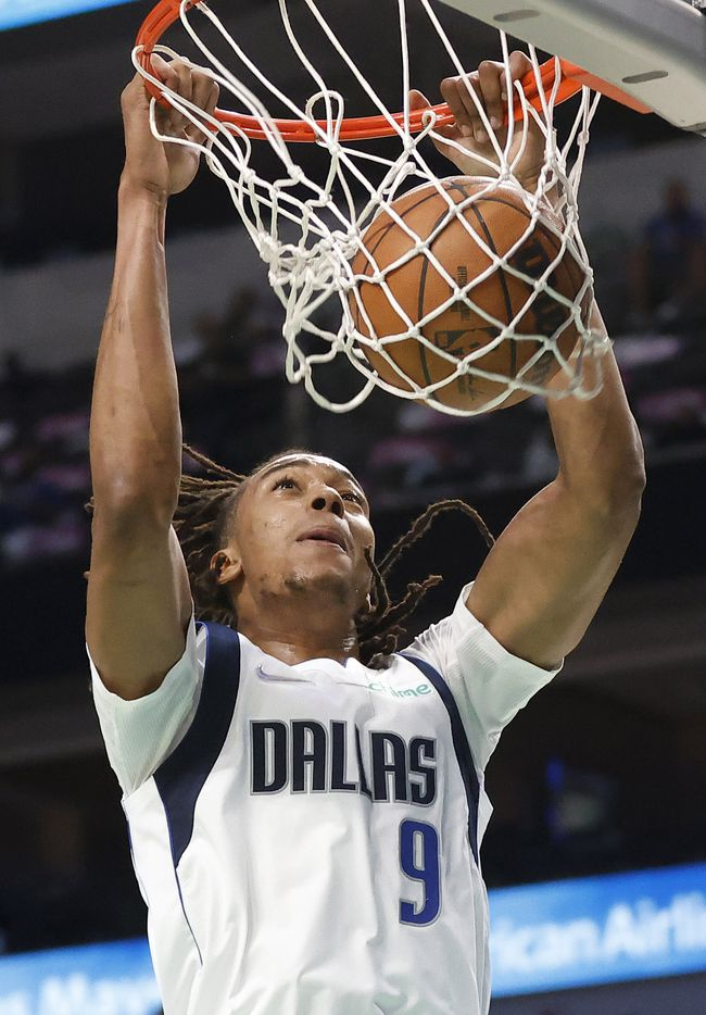 Dallas Mavericks center Moses Brown (9) dunks the ball during the first half against the Utah Jazz at the American Airlines Center in Dallas, Wednesday, October 6, 2021.(Tom Fox/The Dallas Morning News)