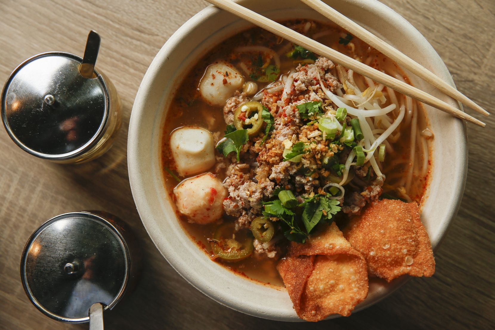 Tom yum moo sub, spicy noodle soup
