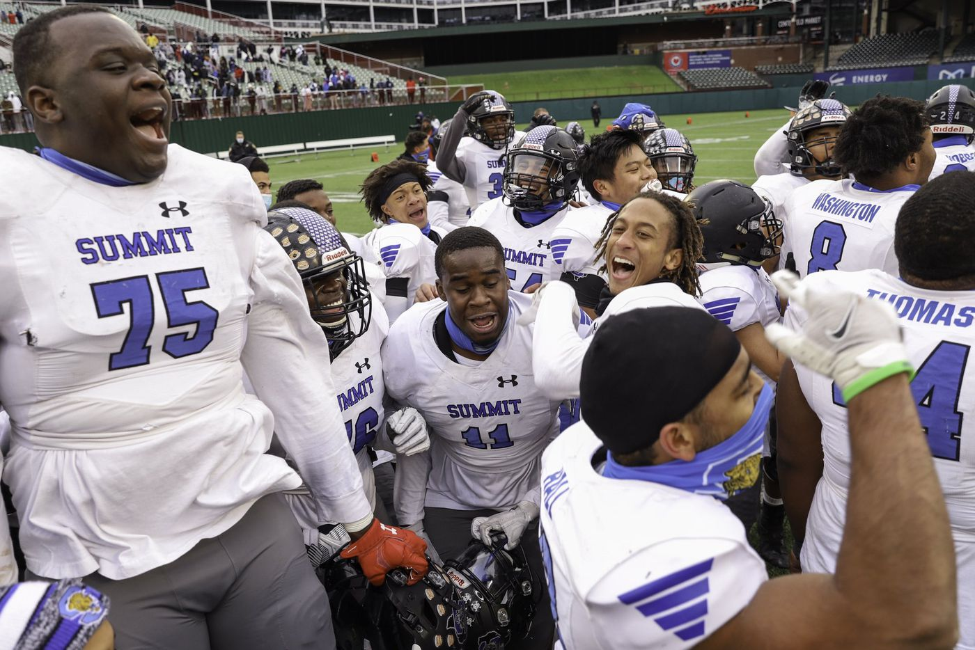 Mansfield Summit players celebrate after their Class 5A Division I Region I final win over Red Oak at Globe Life Park in Arlington, Texas, Friday, Jan. 1, 2021.
