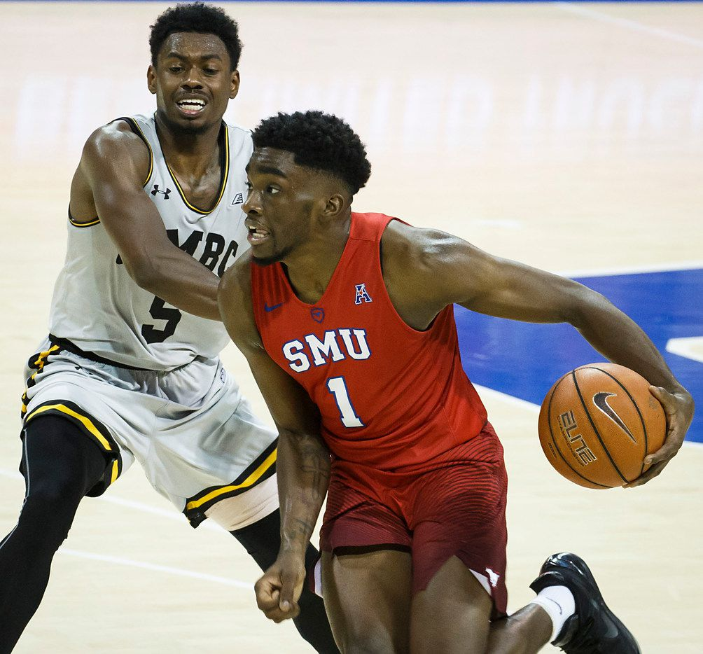 SMU guard Shake Milton (1) drives past UMBC guard Jourdan Grant (5) during the second half of an NCAA men's basketball game at Moody Coliseum on Friday, Nov. 10, 2017, in Dallas. SMU won the game 78-67. (Smiley N. Pool/The Dallas Morning News)