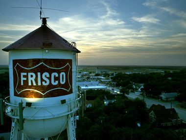 July 30, 2003 --The Frisco water tower looms over downtown at dusk as one of the city's most unique and recognizable landmarks. The Heritage Association of Frisco will be dedicating the tower with a historical marker this coming fall.