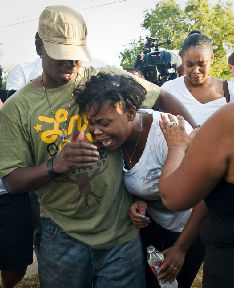Tony Harper, brother of James Harper, embraced his sister Ashley Harper after they learned a Dallas police officer had shot and killed their brother during a confrontation in the Dixon Circle area of South Dallas.