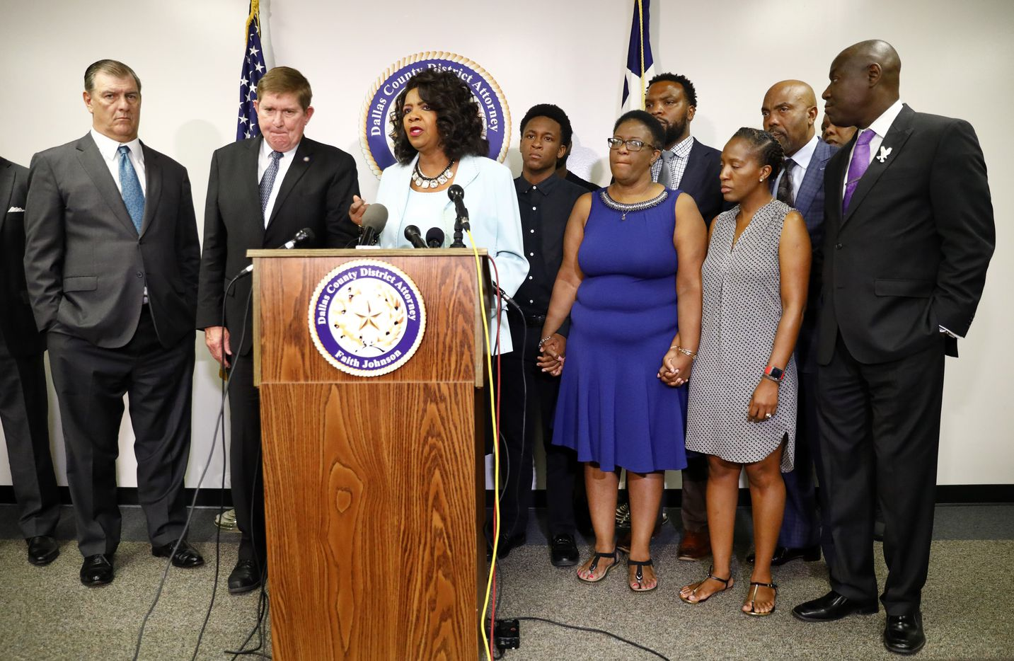 Flanked by family members of Botham Jean and their attorneys (right), Dallas County District Attorney Faith Johnson speaks during a press conference at the Frank Crowley Courts Building in reference to the shooting of Botham Jean by Dallas police officer Amber Guyger, Monday, September 10, 2018. Dallas Mayor Mike Rawlings  (left) spoke as well.
