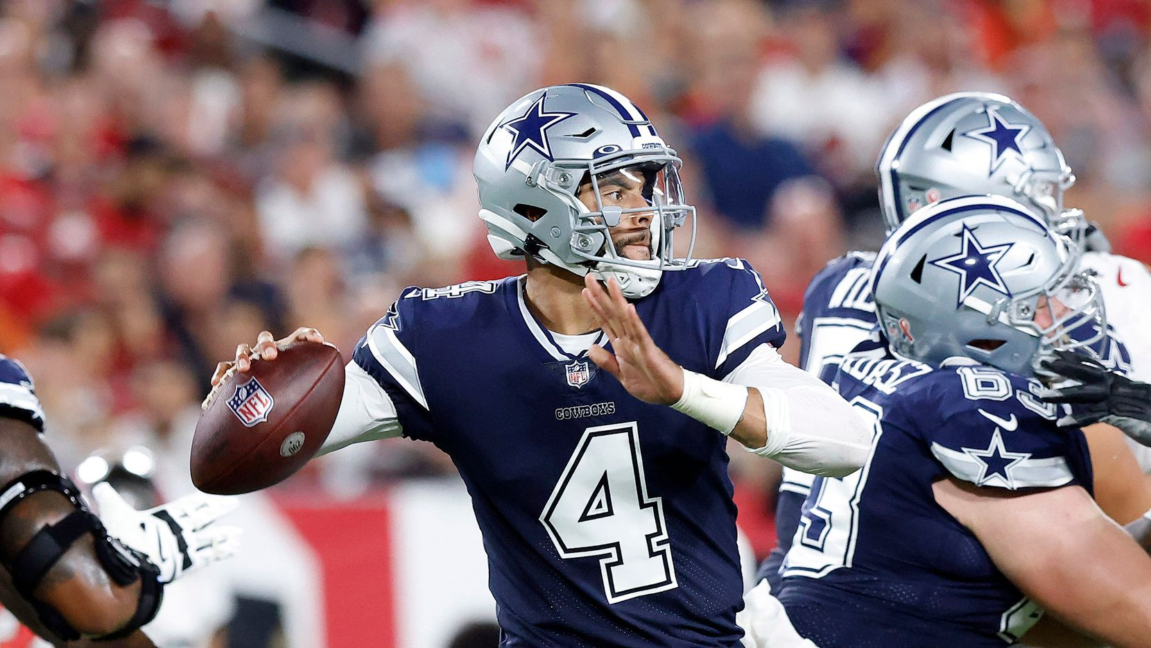 Dallas Cowboys quarterback Dak Prescott (4) throws from the pocket in the first quarter against the Tampa Bay Buccaneers at Raymond James Stadium in Tampa, Florida, Thursday, September 9, 2021. The Cowboys faced the Tampa Bay Buccaneers in the NFL season opener.