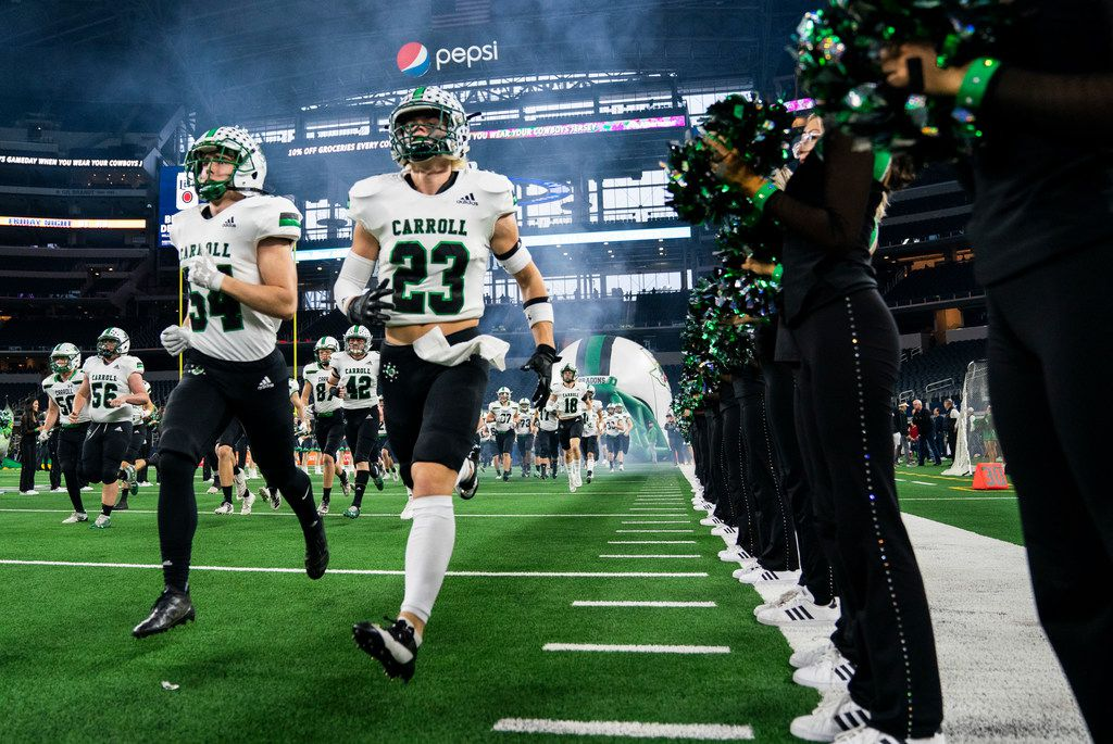 Southlake Carroll football players enter the field before a Class 6A Division I area-round high school football playoff game between Southlake Carroll and DeSoto on Friday, November 22, 2019 at AT&T Stadium in Arlington. (Ashley Landis/The Dallas Morning News)