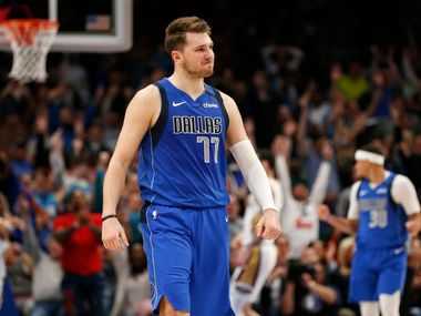 Dallas Mavericks guard Luka Doncic (77) smiles after making a three pointer late in overtime play over New Orleans Pelicans center Derrick Favors (22) at American Airlines Center in Dallas on Wednesday, March 4, 2020. Dallas Mavericks defeated the New Orleans Pelicans 127-123.