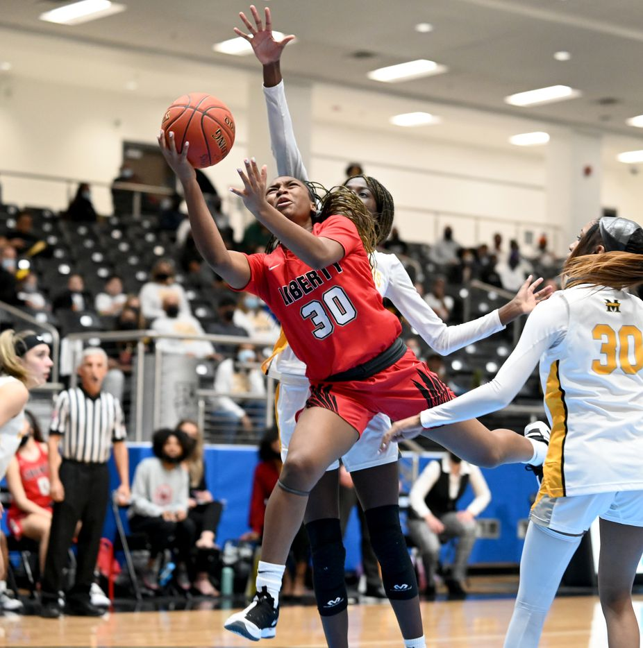 Liberty's Jazzy Owens-Barnett (30) shoots over Falyn Lott in the second half of a Class 5A girls high school playoff basketball game between Frisco Memorial and Frisco Liberty, Wednesday, Feb. 24, 2021, in Frisco, Texas. (Matt Strasen/Special Contributor)