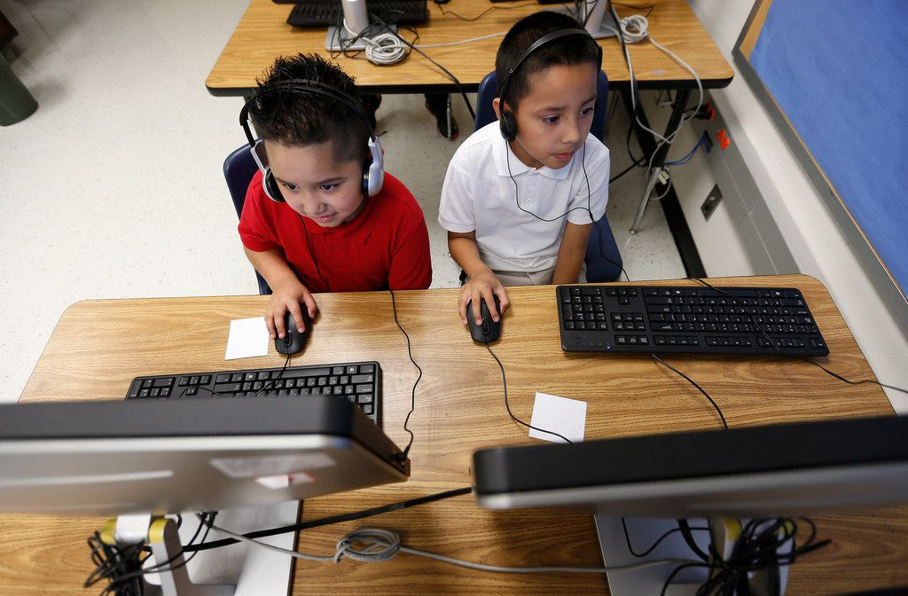 Second graders William Rios (left) and Jose Ramirez work on a debugging lesson during a coding class at Frederick Douglass Elementary in Dallas. Dallas ISD is rapidly expanding computer science instruction to elementary schools across the district, as part of an effort between DISD and Code.org.