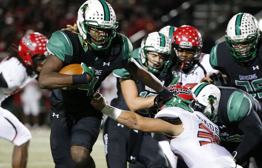 Southlake Carroll running back Lil' Jordan Humphrey (4) carries the ball in the first half during a 6A Division II Region 1 bi-district high school football playoff game between Cedar Hill and Southlake Carroll at Dragon Stadium in Southlake, Texas Friday November 13, 2015. (Andy Jacobsohn/The Dallas Morning News)
