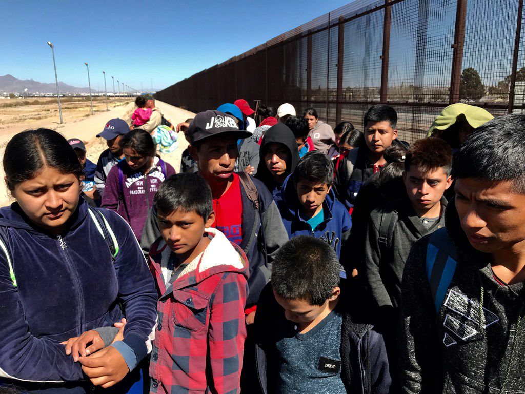 Migrants who crossed the border and turned themselves in to the border patrol were being held along the border fence in an area known as El Paso's Lower Valley in the Ysleta area. More than 700 were detained between El Paso and the Lower Valley on the day this photo was taken, March 6, 2019.