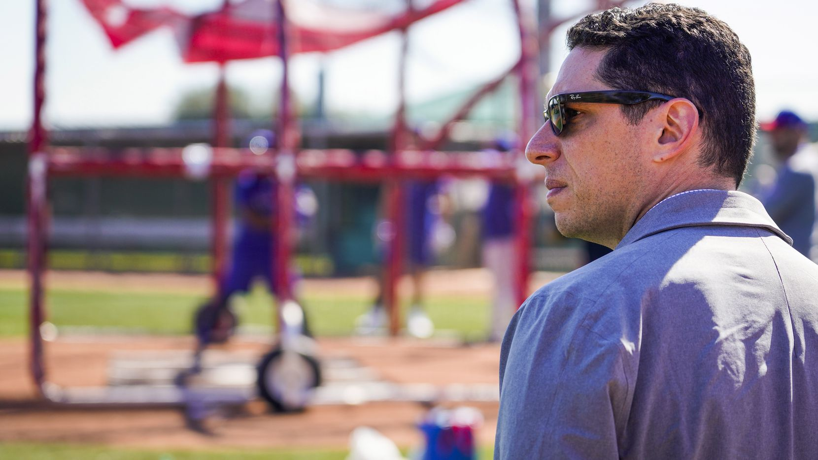 FILE - Rangers general manager Jon Daniels looks on during a spring training workout at the team's training facility on Saturday, Feb. 15, 2020, in Surprise, Ariz.