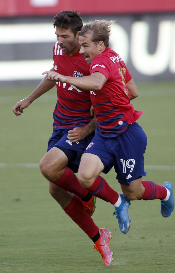 FC Dallas teammates Paxton Pomykal (19), right and Ryan Hollingshead (12) became tangled when their paths crossed during first half action against Minnesota United. The two teams played to a 1-1 draw. The two teams played their MLS match at Toyota Stadium in Frisco on June 19, 2021. (Steve Hamm/ Special Contributor)