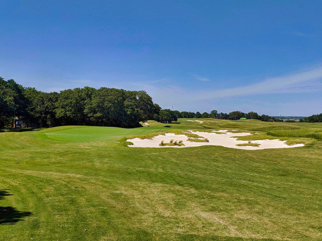 The sixth hole at Texas Rangers Golf Club is a 132-yard par 3. The green is diagonal from the tee box, giving the golfer a narrow target with a prevailing cross wind.