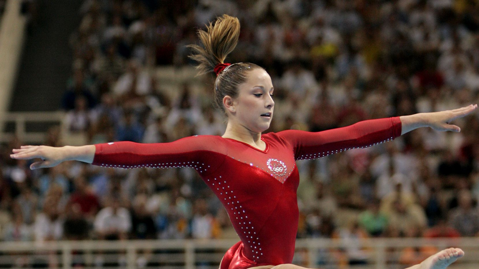 United States' Carly Patterson performs her floor routine during the women's gymnastics individual all-around final at the 2004 Olympic Games in Athens.