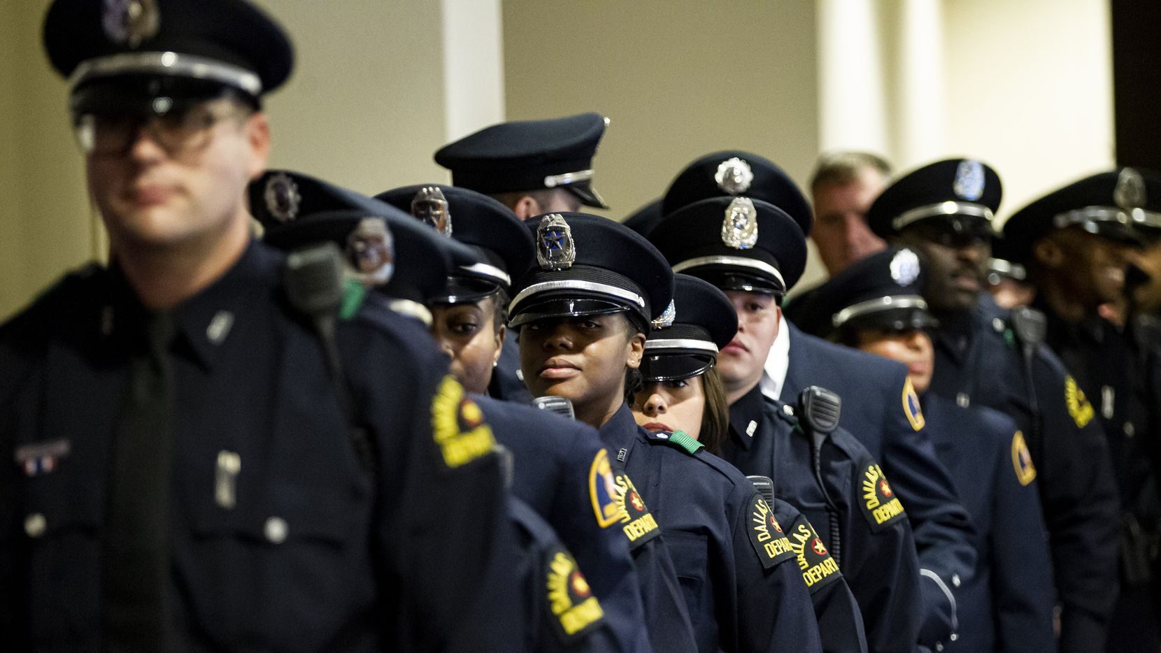 Members of the Dallas Police Academy Class #366 wait to enter their graduation ceremony at the Inspiring Body of Christ Church in Dallas, Friday, January 10, 2020.
