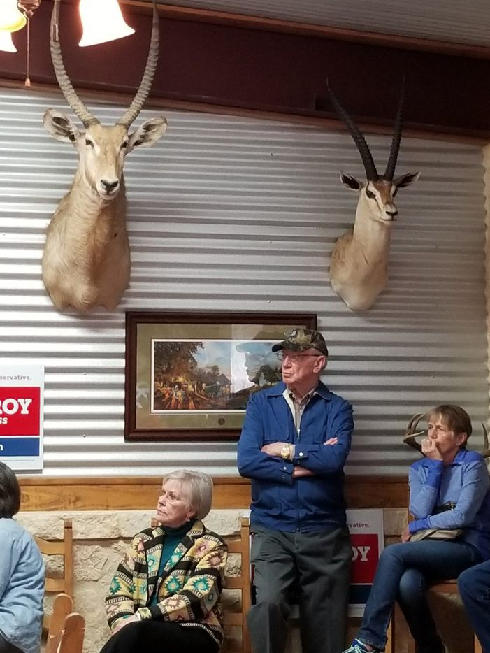 Voters listen at a rally at Buzzie's BBQ in Kerrville, where Sen. Ted Cruz campaigned with congressional candidate Chip Roy on Feb. 10.