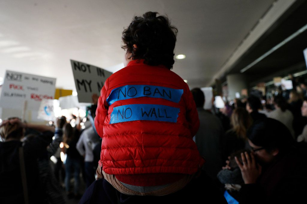 SAN FRANCISCO, CA - JANUARY 28: A child wears a slogan on his jacket during a rally against a ban on Muslim immigration at San Francisco International Airport on January 28, 2017 in San Francisco, California. President Donald Trump signed an executive order Friday that suspends entry of all refugees for 120 days, indefinitely suspends the entries of all Syrian refugees, as well as barring entries from seven predominantly Muslim countries from entering for 90 days. (Photo by Stephen Lam/Getty Images)