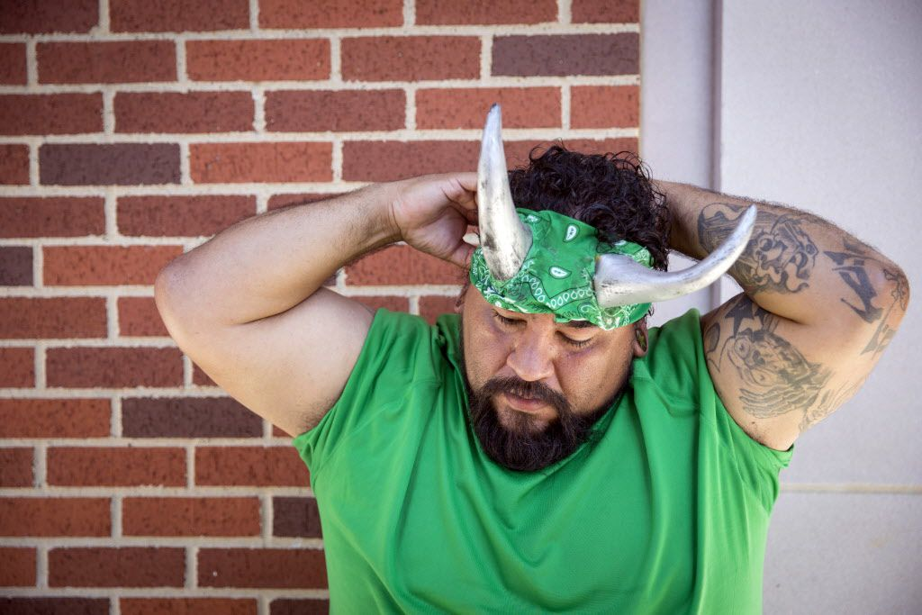 Bam Martinez adjusts his costume before taking part in the Western Days Festival World Tamale Eating Championship Saturday, September 26, 2015 in Lewisville, Texas. A dozen competitors took part in the event, with the winner consuming 61 tamales in 12 minutes. (G.J. McCarthy/The Dallas Morning News)