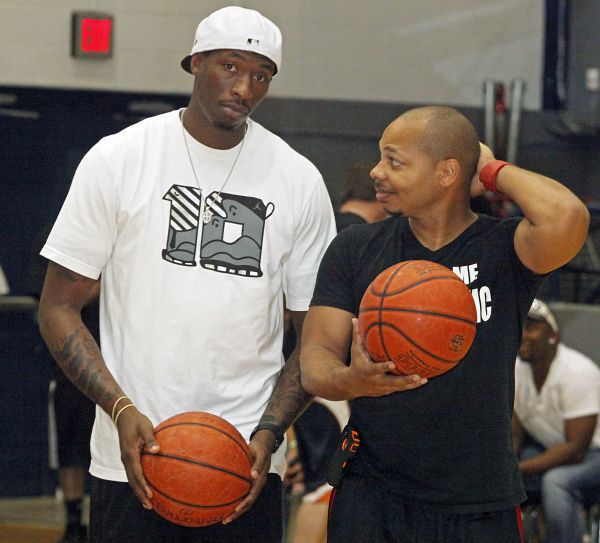"Josh Howard of the Utah Jazz shoots with DJ Red before the fourth annual ""Ballin with the Boys"" charity basketball game to benefit the local Salvation Army. The game was held at R.L. Turner High School in Carrollton on Thursday night, May 31, 2012."