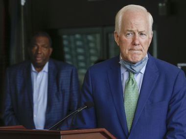 U.S. Senator John Cornyn, R-Texas, addresses members of the media as Texas State Senator Royce West, D-Dallas, listens from behind following a law enforcement roundtable on Friday, June 12, 2020 at City Hall in Dallas. (Ryan Michalesko/The Dallas Morning News)