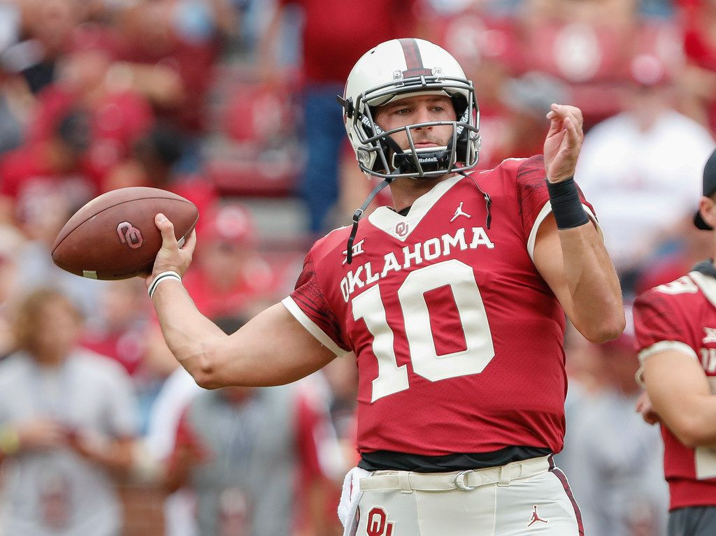Oklahoma quarterback Austin Kendall (10) warms up before the start of an NCAA college football game against Baylor in Norman, Okla., Saturday, Sept. 29, 2018. (AP Photo/Alonzo Adams) ORG XMIT: OKAA125